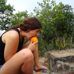 Attempting to eat a very stringy and ripe mango. I'm a classy girl.