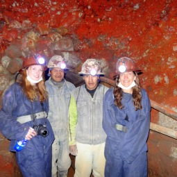 With miners, in a section of tunnel coloured by iron oxide