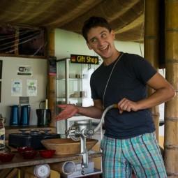Josh grinding coffee beans