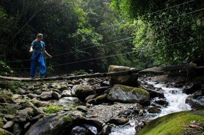 Helen crossing a suspension bridge