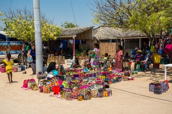 Women selling mochillas, shoulder bags worn across the body by the Wayuu