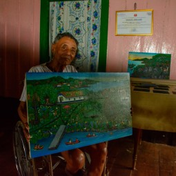 Rodolfo Arellano and the painting we bought